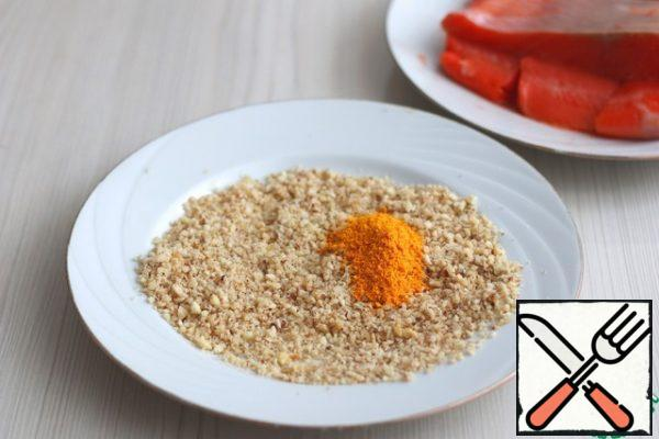 To the chopped nuts, add one tablespoon of tangerine zest, crushed into a powder. Mix the breadcrumbs and nuts in the tangerine powder.