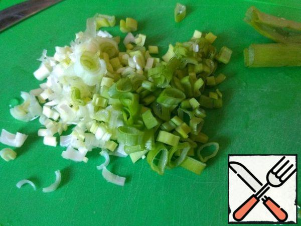 Finely chopped green onions.