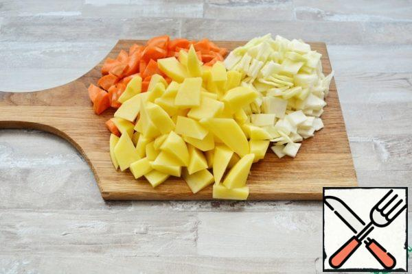 Cut the vegetables into cubes or slices.