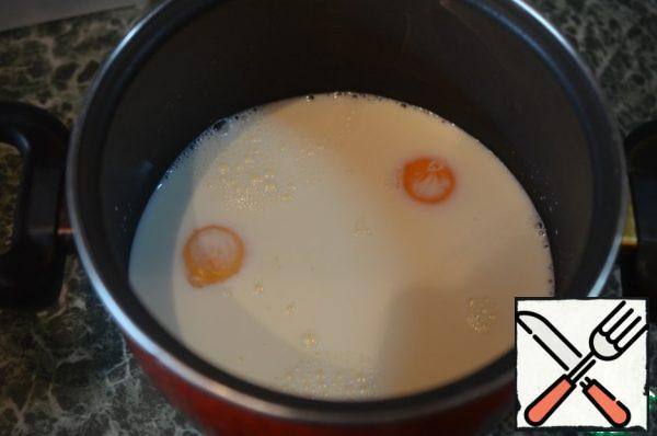 For the cream, heat the milk, beat in the yolks.