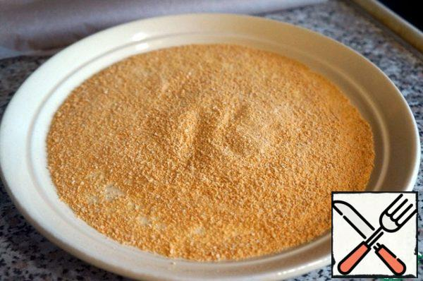Pour the breadcrumbs into a flat dish.