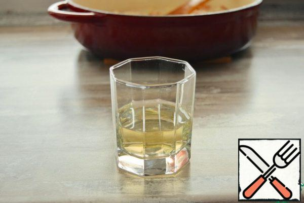 Pour dry white wine into a saucepan with the rice. Cook, stirring, until all the wine is absorbed into the rice. The alcohol will evaporate, from the wine needs to be only the aroma and a slight aftertaste