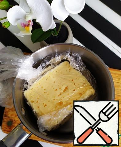 Prepare all the necessary products. Proceed. Put the cheese in a tight plastic bag. Pre-boil water in a saucepan. Put the bag in the pan for 15-20 minutes to completely melt the cheese.