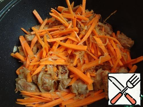 As soon as the onion began to soften and change color-throw the carrots.