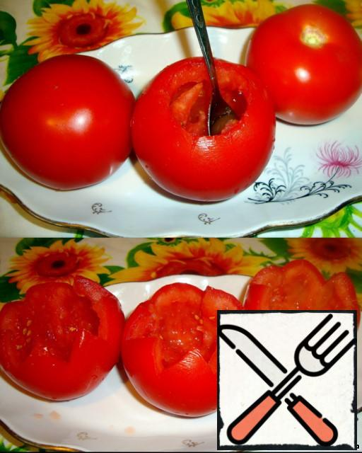 Remove the pulp from the tomatoes. It will go in the salad.