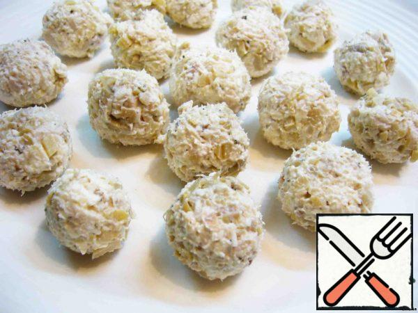 Add salt and pepper, add mayonnaise, mix everything thoroughly and roll the salad into a small ball with a diameter of 3 cm.