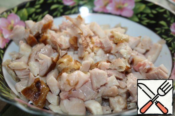 Cut the chicken breast into cubes.