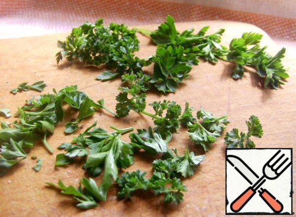 Chop parsley.