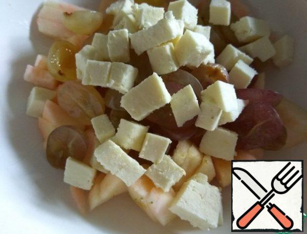Cut the cheese into small pieces and add to the other ingredients.