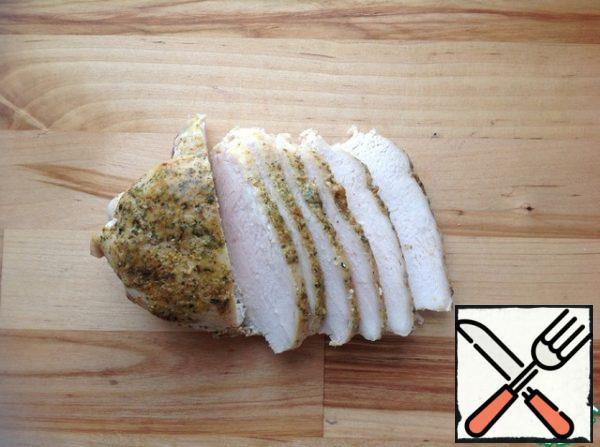 Cut the chicken breast into thin slices.