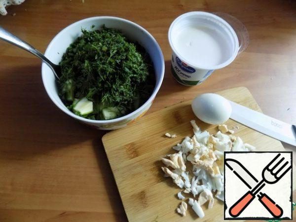 Greens: Swiss chard, dill, onion, cucumber cut finely and put into a salad bowl. Hard-boiled eggs. Two pieces are cut not very small and sent to the salad.