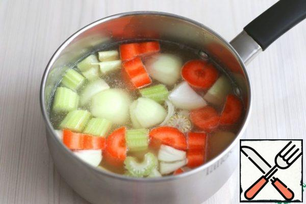 Add chopped vegetables to the prepared meat broth, add a mixture of dried herbs to taste.