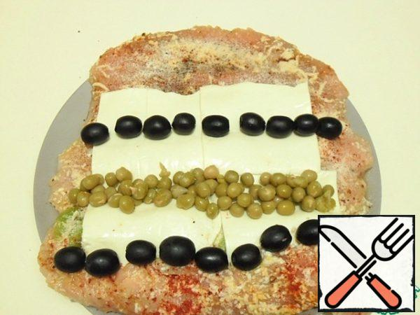 I spread out plates of cheese, olives and peas on it.