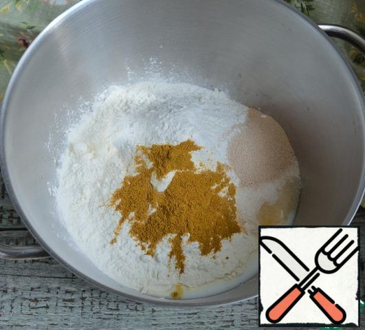 Add salt, sifted flour, turmeric, yeast, and sugar to the warm milk.