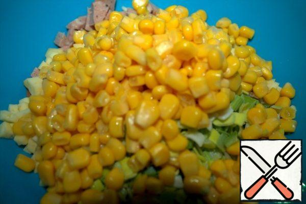 Add grated cheese, onion and corn to the meat.