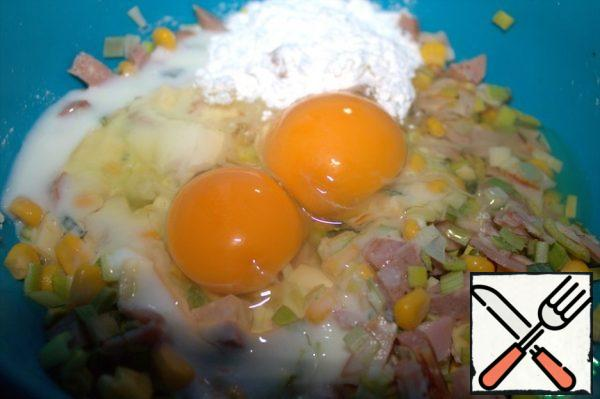 Pour the sour cream or yogurt. Beat in the eggs and add the starch.