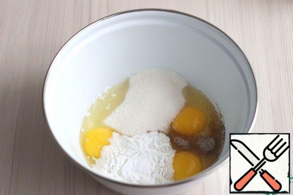 In a bowl, add eggs (3 PCs.), add vanilla sugar (1 pack.), add baking powder (1 pack.), add sugar (90 gr.). Beat the mixture with a mixer.
