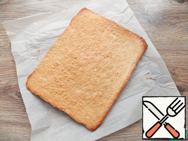 Cover the baking sheet with baking paper and pour out the dough, flatten. Bake in a hot oven at t=180 degrees for 15 minutes, until ready. Remove, cool and remove the paper.