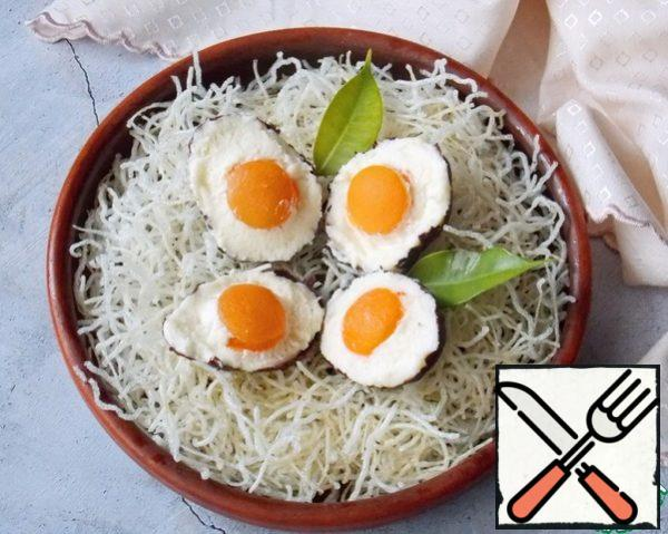 Put the eggs in the nest and serve.