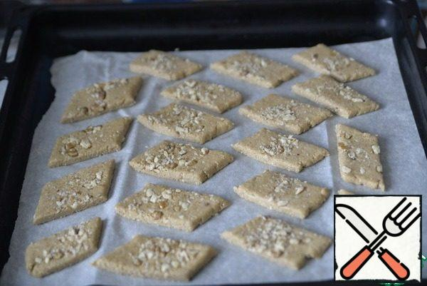 Transfer the cookie blanks to a baking sheet covered with baking paper. Put in a heated oven. Bake the cookies until light Golden at 190 degrees for 20 minutes.
