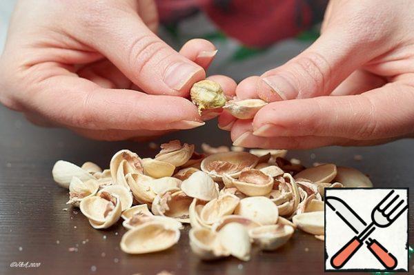 Peel the pistachios.