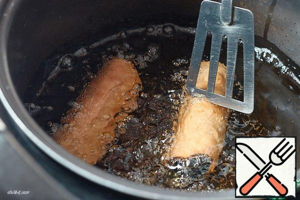 Turning them in the oil, fry them until Golden brown. Don't burn it.