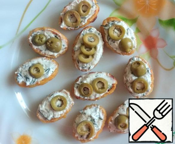 """Fill the halves of the """"shells"""" with cheese, if desired, add chopped olives. Connect the halves."""