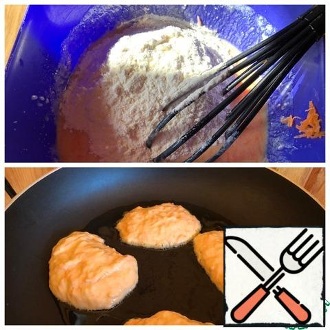 Add the slaked soda and flour. Knead the dough and let it stand for 15 minutes. Bake pancakes on medium heat on both sides in vegetable oil with the lid closed.