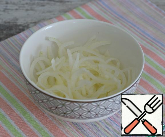 Onions cut into half rings, scalded with boiling water, and then washed in cold water. Wring.
