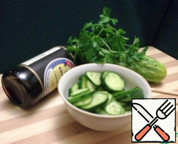 Pour the dressing over the prepared cucumbers. Stir.
