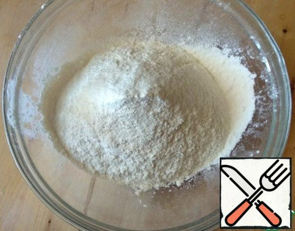 For the dough, sift the flour into a bowl.