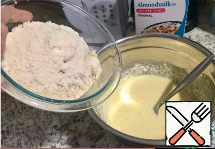 Gradually add the almond and coconut flour (I mixed them together), baking powder and cinnamon.