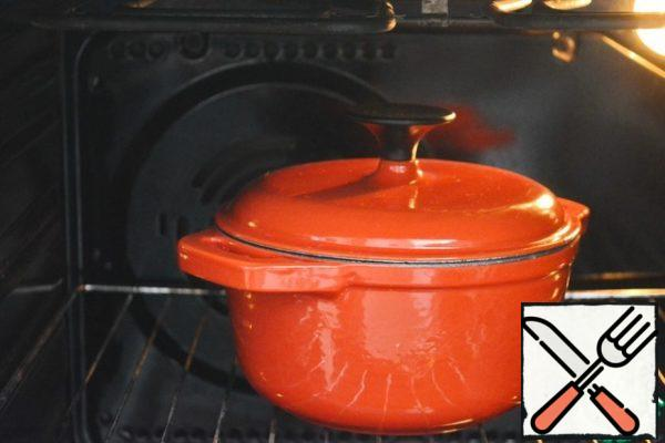Cover the pan with a lid, put the soup in a hot oven and simmer for another half hour at 150-160°C.I used a cast-iron enamel pot, but you can cook in a ceramic one. You can also pour the soup into serving pots and finish cooking in pots.
