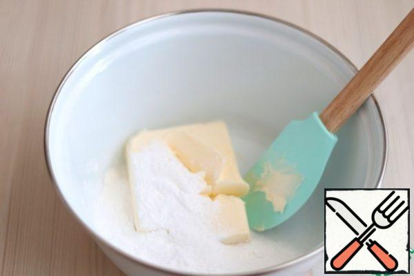 In a separate bowl, add the butter (180 gr.). add the powdered sugar (90 gr.). RUB the Mixture with a spatula until smooth and light.