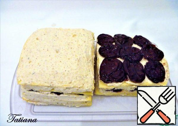 Assembling cheese sandwiches for canapes (two sandwiches with 4 layers of cheese): Cover the Assembly surface with plastic wrap and lay it out in layers: - slice of cheese -a thin layer of cheese and nut paste - slice of cheese -a thin layer of cheese and nut paste - dried plums (9 PCs.) -a thin layer of cheese and nut paste - slice of cheese -a thin layer of cheese and nut paste - dried plums (9 PCs.) -a thin layer of cheese and nut paste - slice of cheese -a thin layer of cheese and nut paste Repeat with the remaining cheese. You'll get two big sandwiches. Wrap the cheese sandwiches (separately) in plastic wrap and put them in the refrigerator for 10-12 hours. (day).