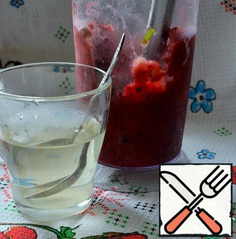 Put it in the bowl of a blender and chop it. Dissolve the sugar in boiling water.