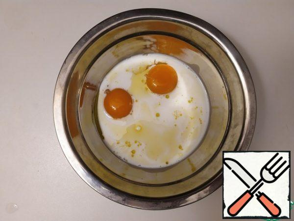 Add olive oil and milk to the yolks.