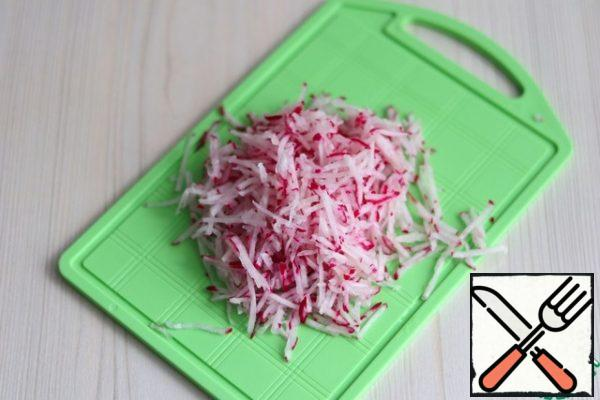 Grate the radish on a grater for Korean salads with a small section.
