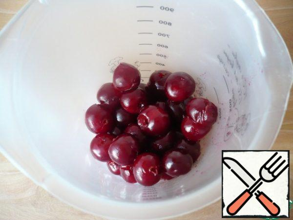 Remove the seeds from each cherry. Put the peeled cherries in a bowl.