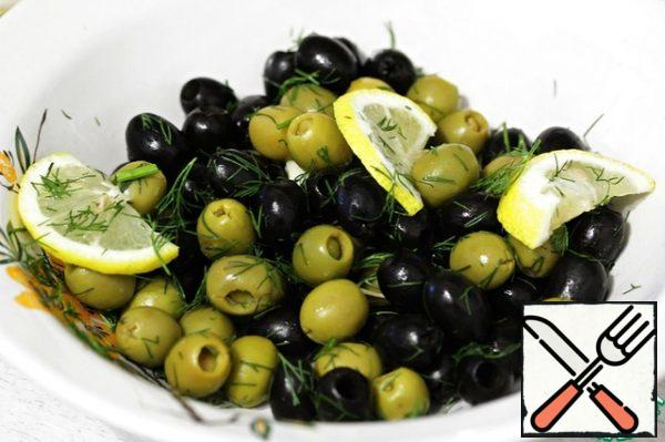 Put the olives in a deep bowl, add the dill, garlic and lemons.