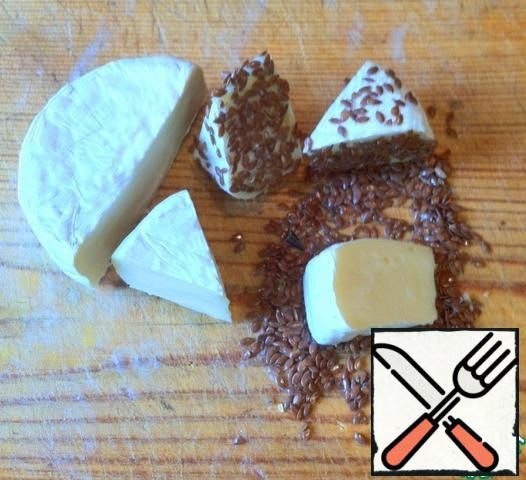 Cut the Camembert circle into 8 sections and roll it in Flaxseed. It can be successfully replaced with sesame.