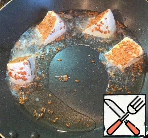 Fry the cheese slices in hot oil on all sides.