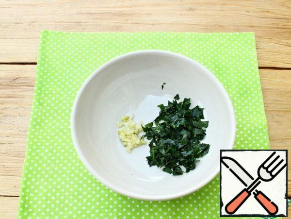 Peeled garlic will pass through the press. Parsley leaves (stems are not used) finely chop and combine with garlic.