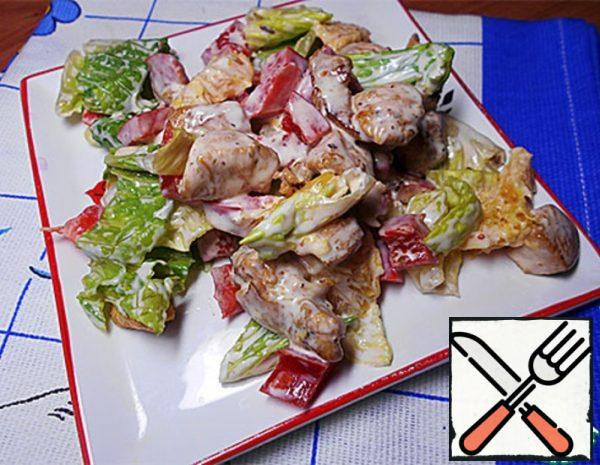 1. Cut the chicken breasts into cubes. 2. Fry the chicken cubes in a little vegetable oil on all sides.  Season well with a mixture of peppers and curry.  Drizzle over soy sauce and cook until the sauce has evaporated. 3. Remove the chicken cubes with a slotted spoon and place in a sieve to glass the oil.  Then put in a salad bowl. 4. Cut the bell peppers into pieces and add to the chicken. 5. Tear the Romano lettuce leaves with your hands.  If you cut with a knife, the taste is lost. 6. Peel and film the oranges, collecting the juice in a salad bowl.  Disassemble into segments.  Add orange pulp to salad.  (Oranges should be juicy and tasty. A bad orange will kill the taste. Be sure to taste the oranges). 7. Mix all products.  Salt a little.  Mix yoghurt with mayonnaise and season salad.