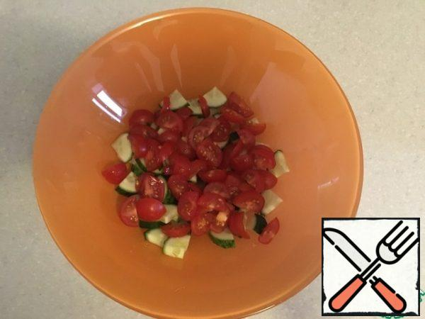 Cut the cherry tomatoes.