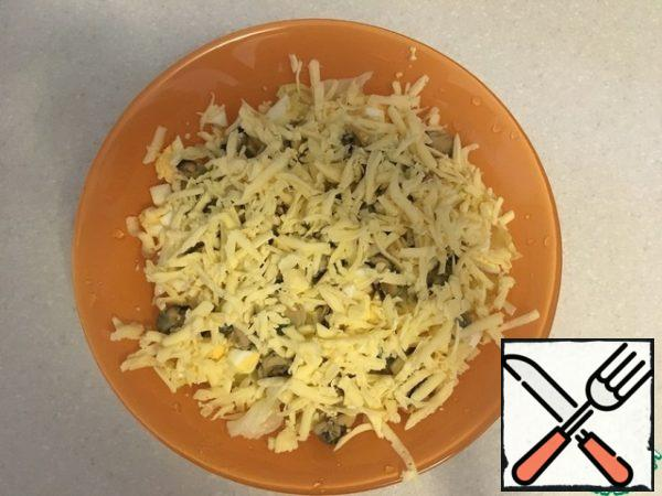 Add the cheese, rubbed on a large grater.