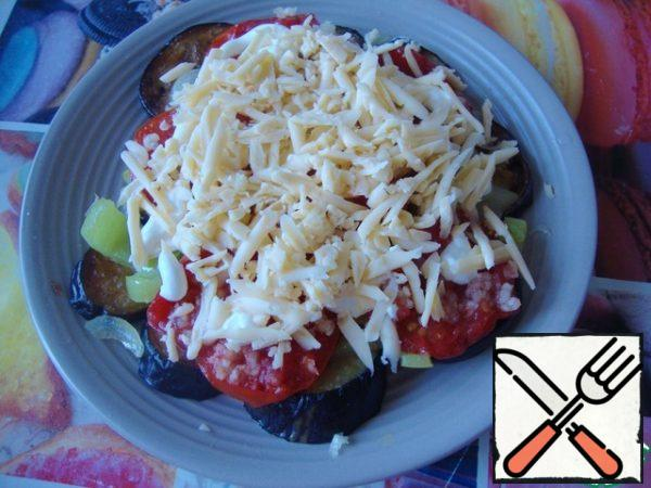 Top with grated cheese and put in the microwave for 1.5-2 minutes for the cheese to melt.