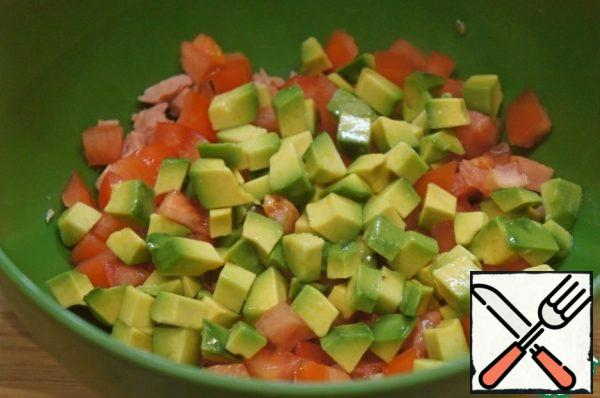 Add the avocado, cut into the same small cubes.