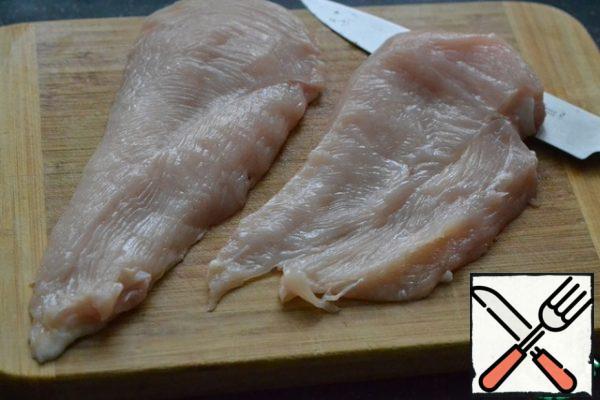 Cut the chicken breast in half.