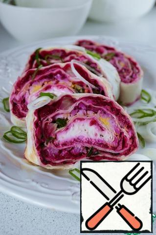 Before serving, cut the roll into pieces. Bon Appetit!